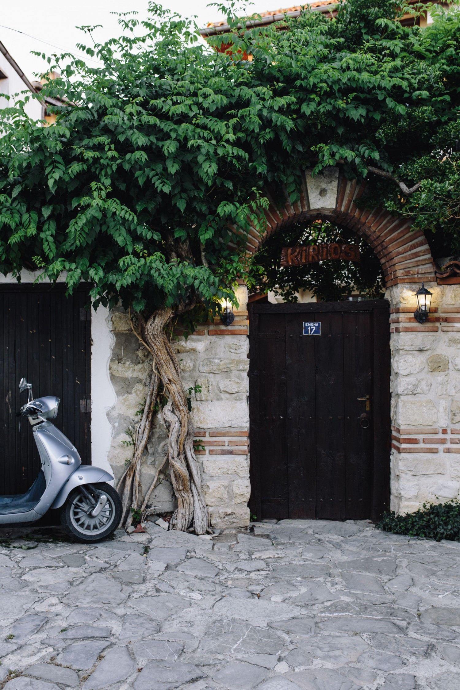 kaboompics_scooter-parked-next-to-the-door-on-an-old-street-in-nessebar-bulgaria